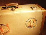 Brown Antique Suitcase Covered in Travel Stickers Photographic Print