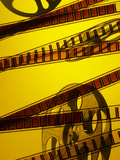 Movie Film and Reel in Yellow Light Photographic Print