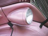 Sleek Headlight on Sporty Pink Car Photographic Print