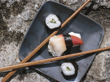 Sushi and Chopsticks Beside Rushing Water Photographic Print