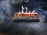 Computer Keyboard on Fire and Smoking Photographic Print