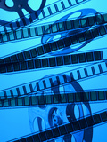 Movie Film and Reel in Blue Light Photographic Print