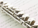 Silver Flute on Sheet of Music Photographic Print