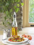 Flavored Oil and Salt and Pepper Shakers Beside Bowl of Pasta Photographic Print