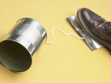 Person Stepping on Tin Can Communication Device Photographic Print