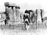 A Naked Hippy Watches Stonehenge from Behind Barb Wire on Summer Solstice Photographic Print