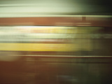 Blur of Passing Subway Photographic Print