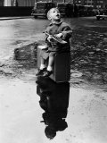 Little Boy Sits on His Suitcase Waiting for a Train to Take Him to the Seaside Photographic Print