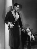 Man Models a Wool Jersey Dressing Gown and His Wire- Haired Fox Terrier Poses for the Camera Photographic Print