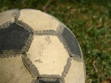 Worn Soccer Ball Photographic Print