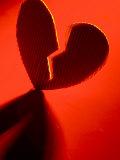 Cardboard Broken Heart in Red Light Photographic Print