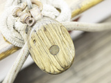 Wooden Pulley and Rope on Edge of Boat Photographic Print