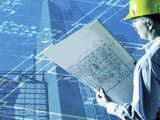 Construction Worker Reviewing a Drafting Plan Photographic Print