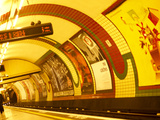 Lights and Advertisements in London Underground Train Station Photographic Print