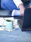 Mug of Coffee on Carpet Beside Laptop Computer Photographic Print