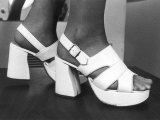 Close-Up Photograph of Feet in a Pair of White Platform Sandals Photographic Print