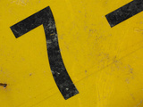 Close-up of the Number Seven on a Yellow Background Photographic Print