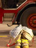 Firefighting Gear with Truck in Background Photographic Print