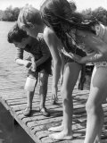 Group of Children Fishing from a Jetty Photographic Print