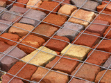 Many Bright Colorful Freshly Baked Bricks Under Wire Mesh Photographic Print