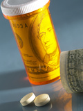 Pill Bottle with Cash Inside Photographic Print