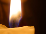 Lit Candle Photographic Print