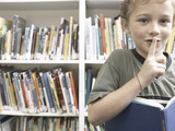 Quiet Little Boy Reading Library Book Reprodukcja zdjęcia