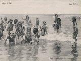 Group of Children in Striped Bathing Costumes Paddle Happily in the Surf at Heyst Sur Mer Belgium Photographic Print