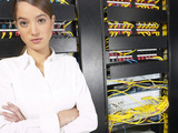 Woman Standing Next to Row of Computer Cables Photographic Print