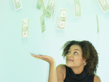 Woman Looking at Money Photographic Print