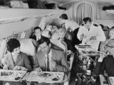 An Airline Steward and Air Hostess Serve a Roast Meal to Flight Passengers Photographic Print