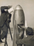 German Rocket Experiments on a Windswept Spit of Land, Filling the Device with Its Chemical Fuel Reprodukcja zdjęcia