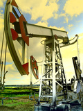 Oil Wells Against Blue Sky Photographic Print