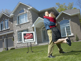 Embracing Young Couple Who Have Just Bought a House Photographic Print