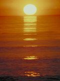 Sun Setting on the Ocean Photographic Print
