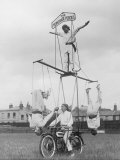 "Motorcycle Acrobat Troupe Called ""The Promenade Percies"" Practise Their Act Involving Balance Stampa fotografica"