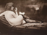 Portrait of a Young Woman Posing Naked, with Her Back Turned, as She Smokes a Cigarette Photographie