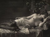 A Barebreasted Young Woman Lying Down, Wearing Shoes and Lingerie Photographic Print