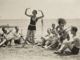 A Young Woman, Surrounded by Musicians, Dances on a Beach of the Lido of Venice Lámina fotográfica