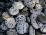 Prayer on Stones at the Feet of a Buddha (Senyu-Ji), Japan Photographie