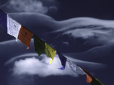 Prayer Flags Infront of Clouds, Nepal Print by Michael Brown