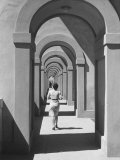 Young Woman Passing Under a Portico Photographic Print