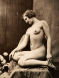 Nude Portrait of a Young Woman Seated with Her Legs Curled Up Photographic Print