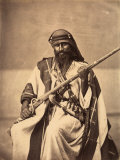 Full-Length Portrait of a Young Bedouin in Ethnic Costume Photographie