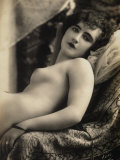 A Young Woman Posing Nude on a Couch Photographic Print
