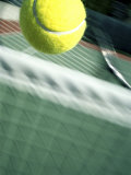 Tennis Racquet, Ball and Net Impresso fotogrfica