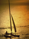 Silhouette of a Sailboat in the Sea Photographic Print