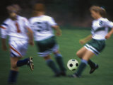 Girls Playing Soccer on a Field Photographic Print