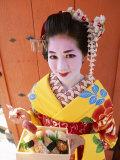Eating Sushi, Apprentice Geisha (Maiko) Dressed in Kimono, Kyoto, Honshu, Japan Photographic Print