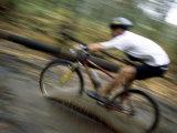 Mountain Biking Through a Mudpuddle Photographic Print